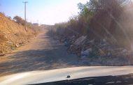 Vecino de El Talhuén denuncia que camino de acceso está lleno de basura